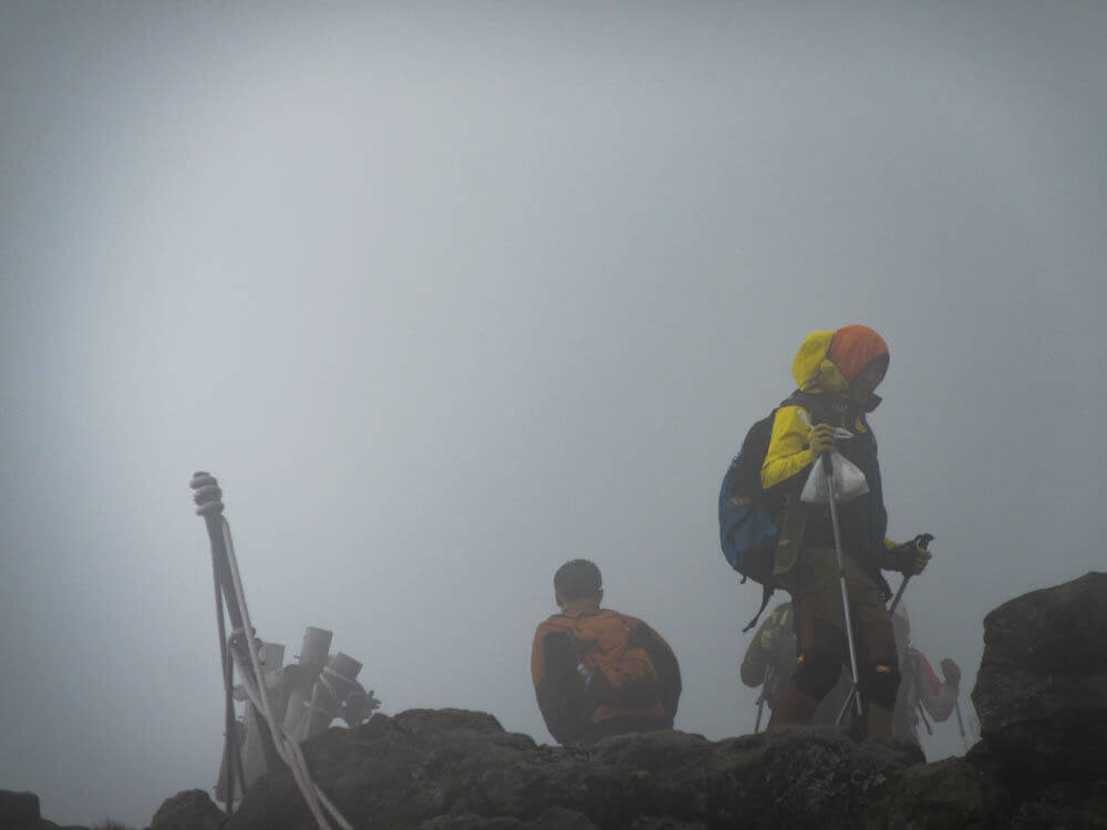 Korean on top of Hallasan mountain in the mist