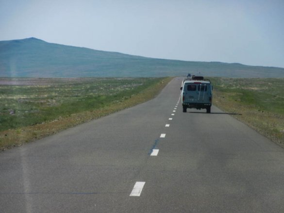Russian 4WD van driving through the Gobi desert.