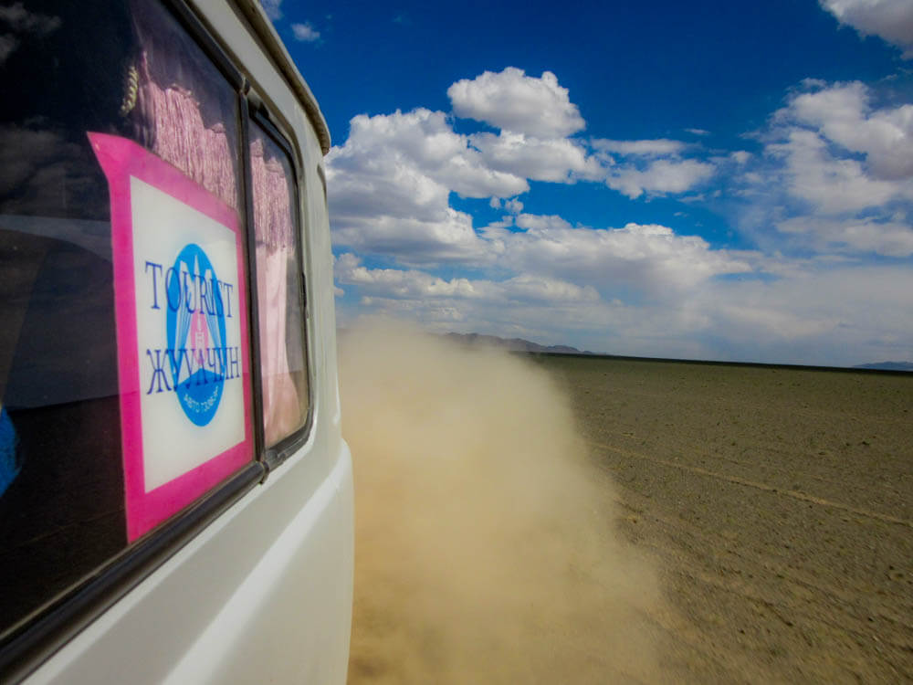 Russian 4WD van driving through the Gobi desert