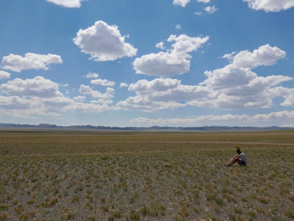 Rick sitting in the vast landscape in the Gobi desert